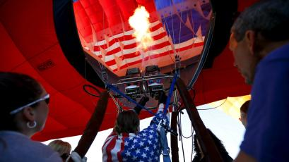 A pilot fills a hot air balloon at sunrise on day one of the 2015 New Jersey Festival of Ballooning in the US.