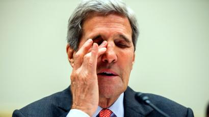 Secretary of State John Kerry pauses while testifying on Capitol Hill in Washington, Washington, Tuesday, July 28, 2015, before the committee's hearing on the Iran Nuclear Agreement. Kerry warned that if they vote to disapprove the nuclear deal negotiated with Iran, Tehran will move forward toward an atomic bomb, international sanctions will crumble and the U.S. will be left without with any of the access and inspections that are part of the deal.