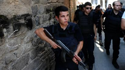 Turkish police officers conduct a security operation in Diyarbakir, southeastern Turkey, Saturday, Aug. 15, 2015.