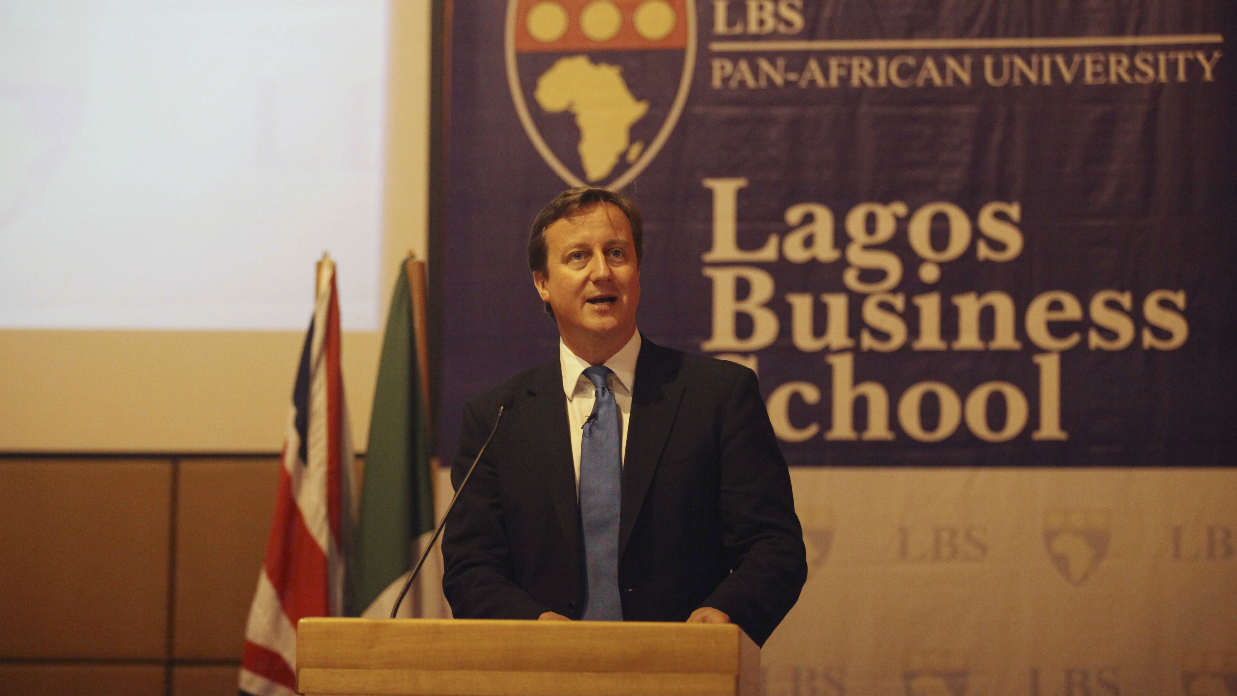British Prime Minister David Cameron, speaks at the Pan African University Business School in Lagos, Nigeria, Tuesday, July 19, 2011. Cameron was flying home early from an African trade mission to concentrate on the escalating crisis in London over phone hacking and police links with the media. (AP Photo/Sunday Alamba)