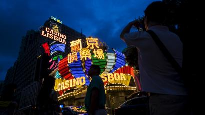Mainland Chinese visitors are pictured in front of Casino Lisboa in Macau.
