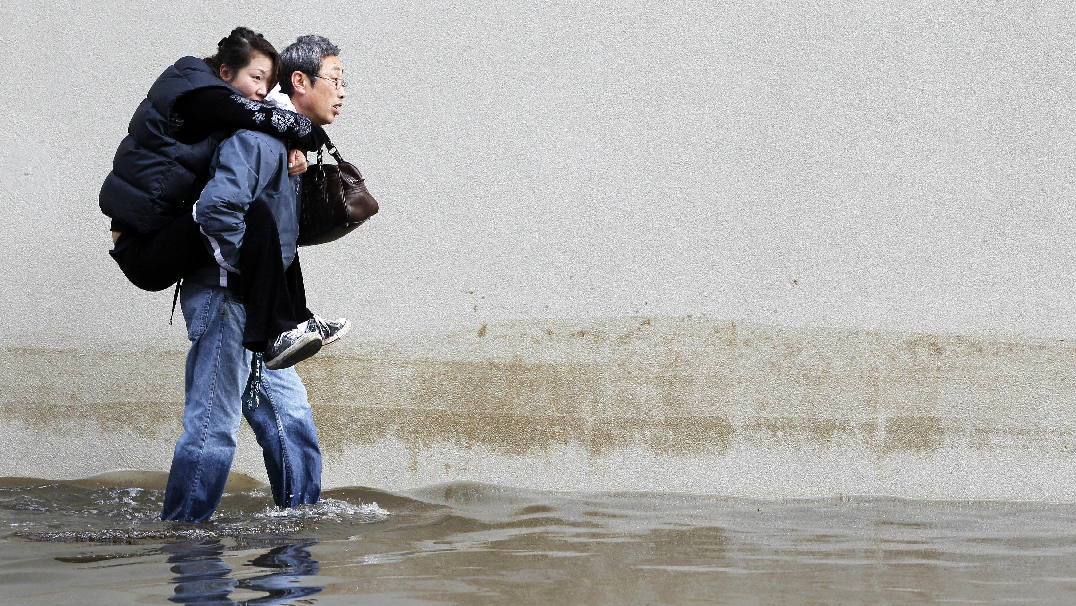 man walking through flooding