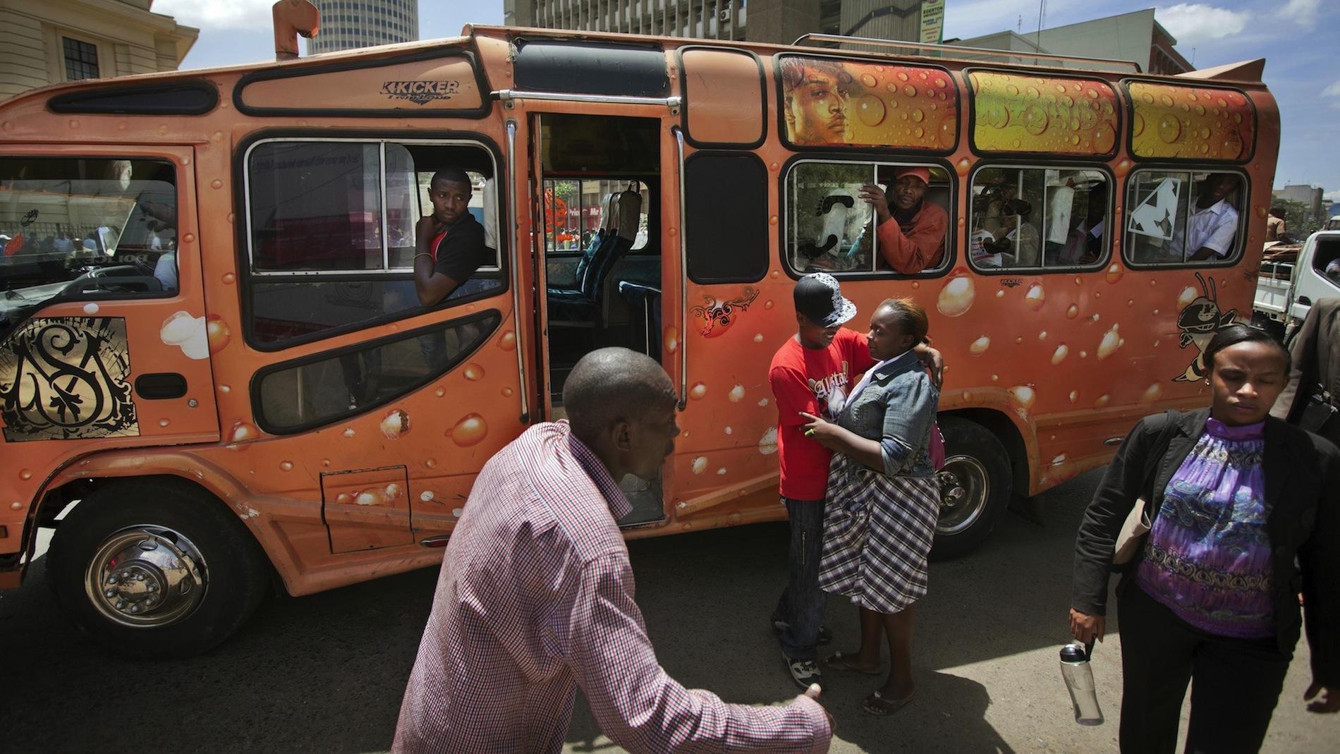 "Matatu operators try to coax passengers on board their bus ""Mist"" in Nairobi."