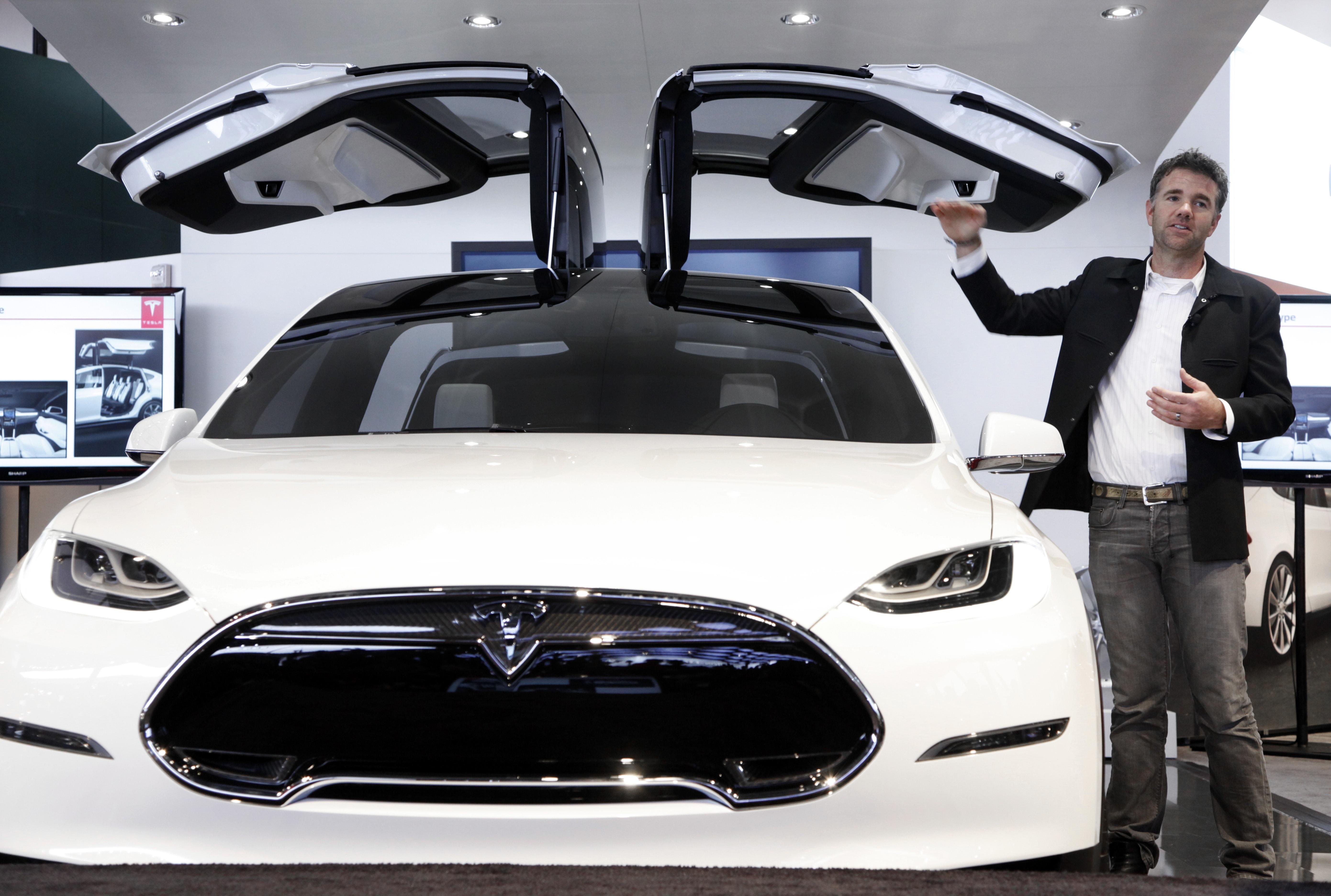 Franz von Holzhausen, Chief Designer, Tesla Motors talks about the doors on the Tesla Model X at the North American International Auto Show in Detroit, Jan. 15, 2013.
