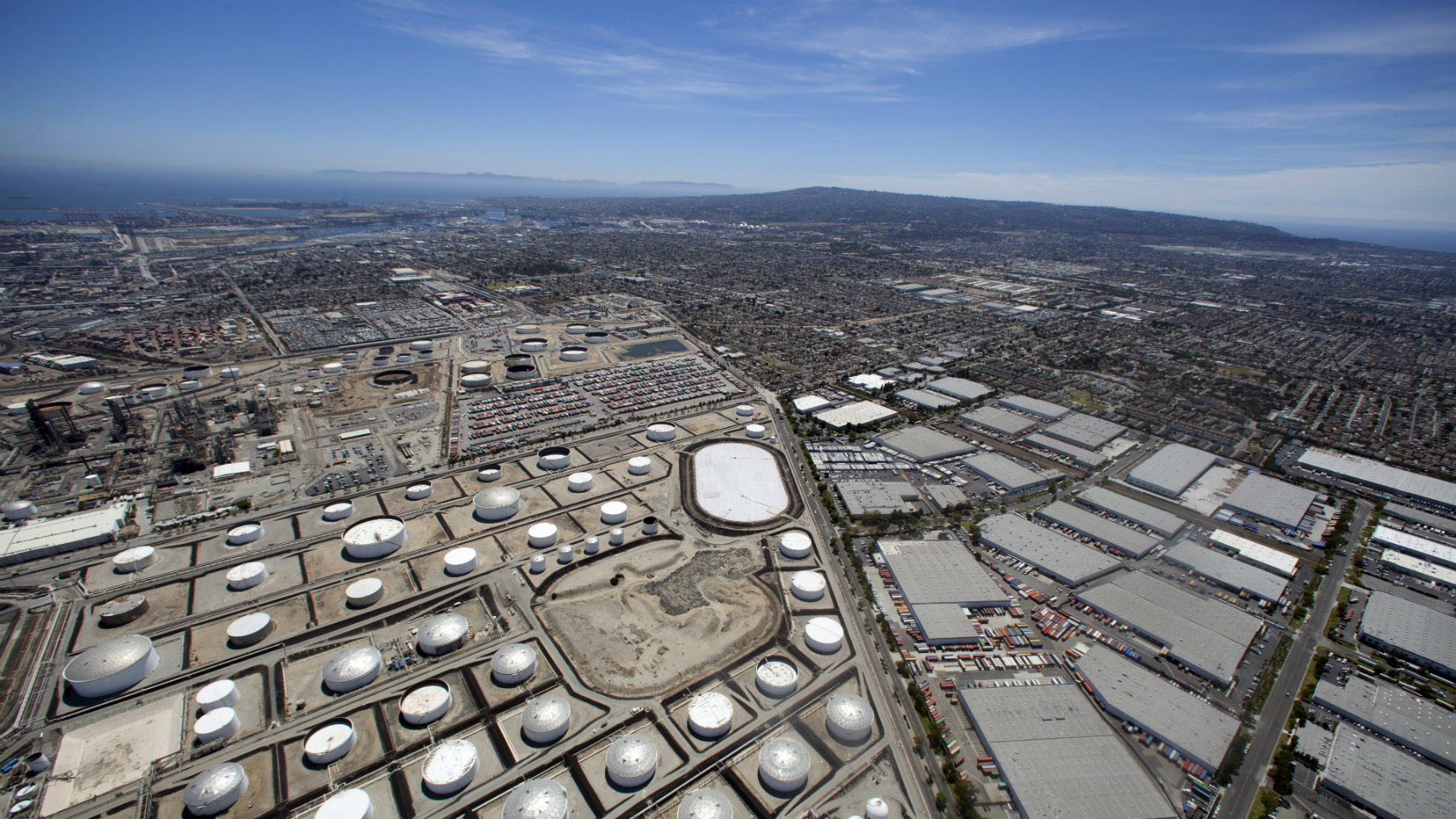 An oil refinery is viewed from the air in Carson, California.