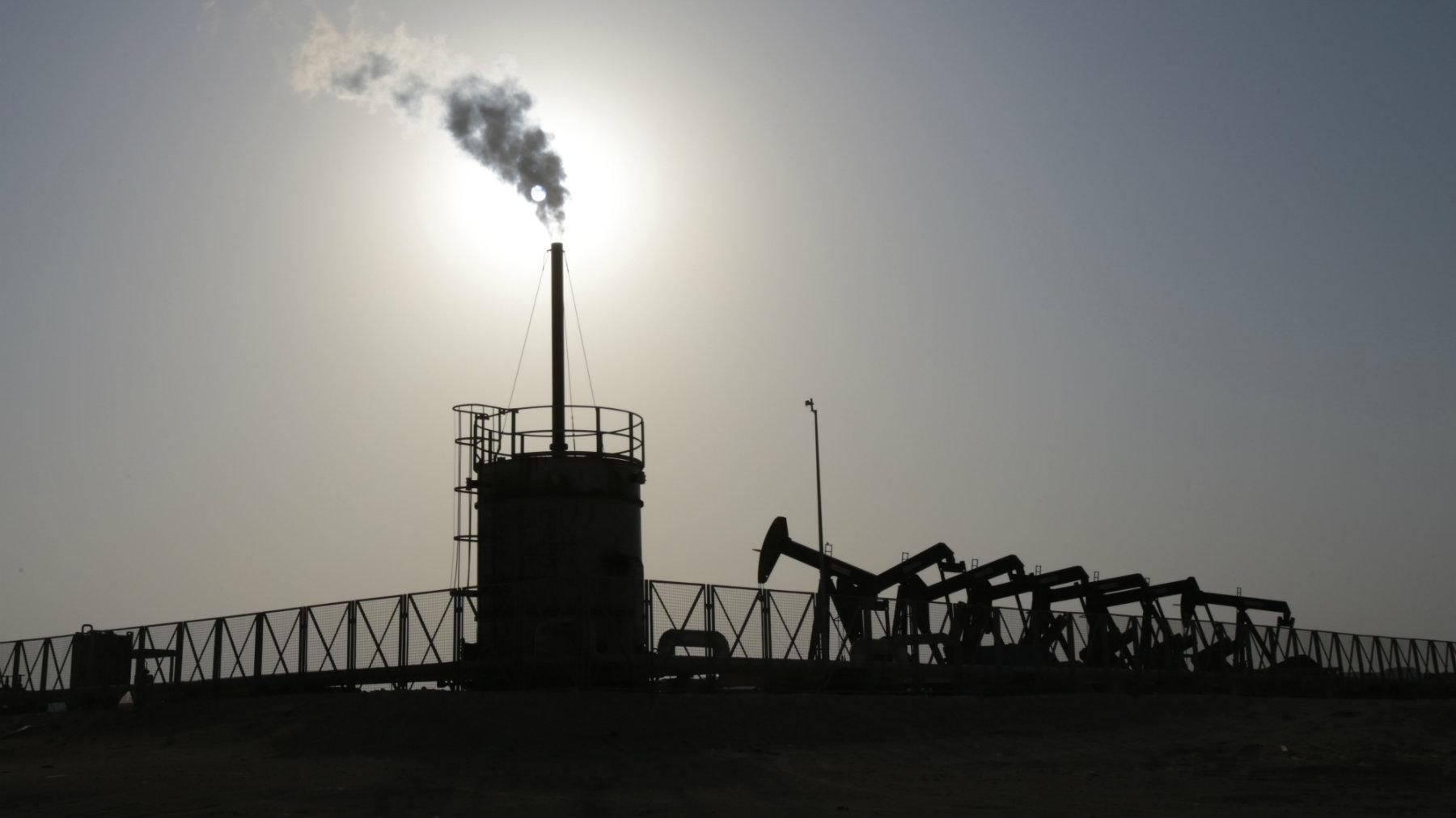 Oil pumps at work in the desert oil fields of Sakhir, Bahrain.
