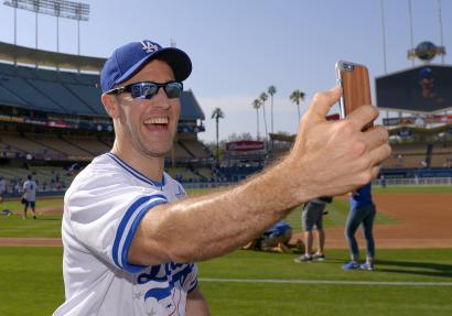 Actor James Van Der Beek broadcasts live via Periscope prior to a celebrity baseball game before a game between the Los Angeles Dodgers and the St. Louis Cardinals, Saturday, June 6, 2015, in Los Angeles. (AP Photo/Mark J. Terrill)