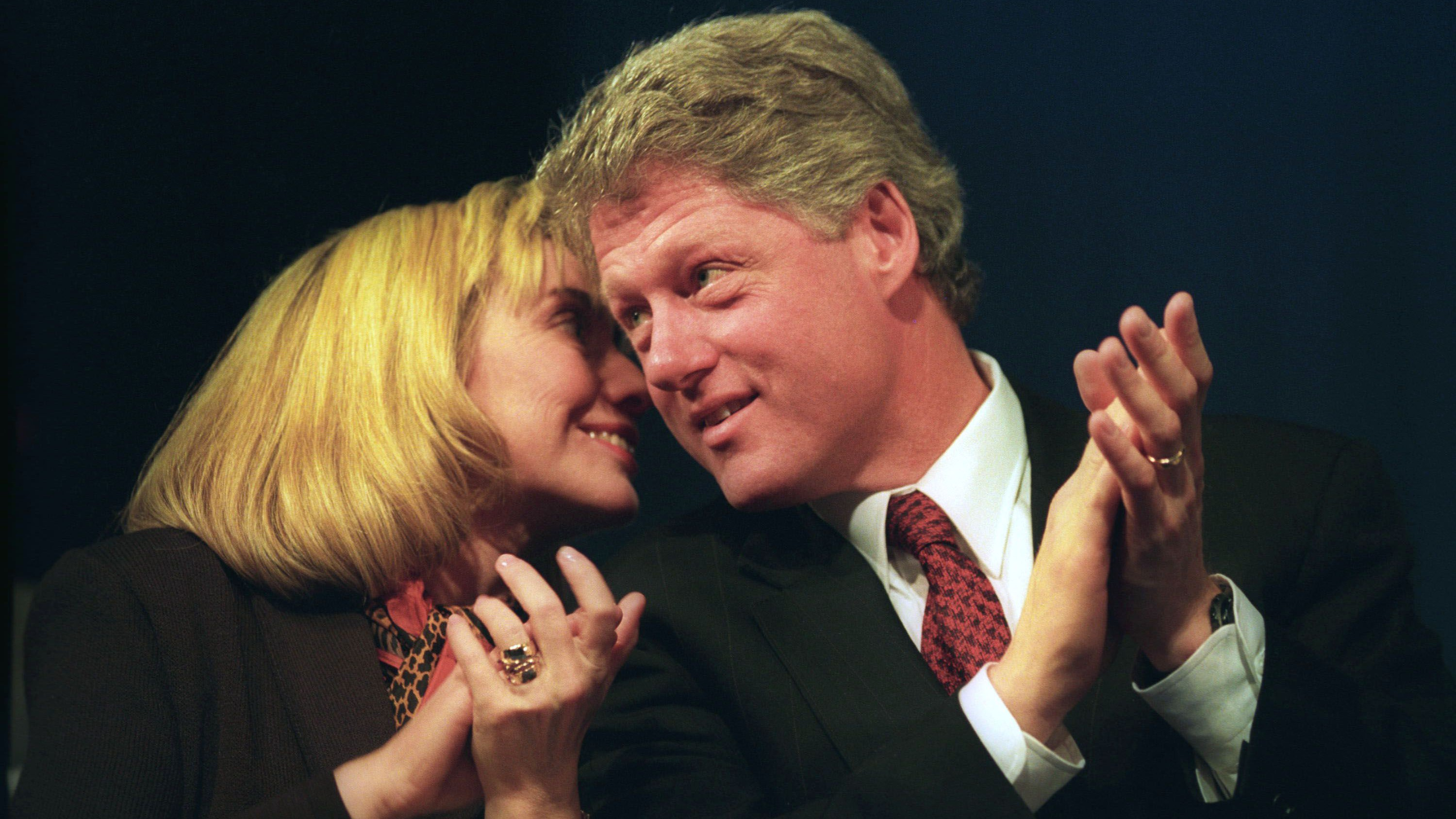 Hillary Clinton whispers to Bill Clinton during a campaign rally in 1993.