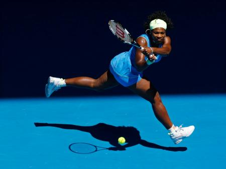 Serena Williams of the U.S. returns to Belarus' Victoria Azarenka during their match at the Australian Open tennis tournament in Melbourne January 26, 2009.