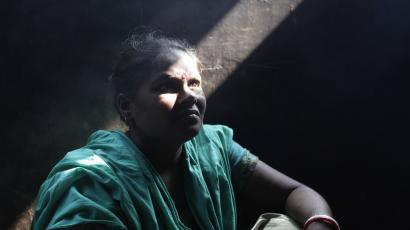 Sabita Rani, 35, who survived a devastating fire at a garment factory, sits in her kitchen in Savar November 30, 2012. Rani, an operator of Tazreen Fashions garment factory, escaped the fire which killed more than 100 workers on November 24.