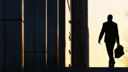 A worker arrives at his office in the Canary Wharf business district in London.