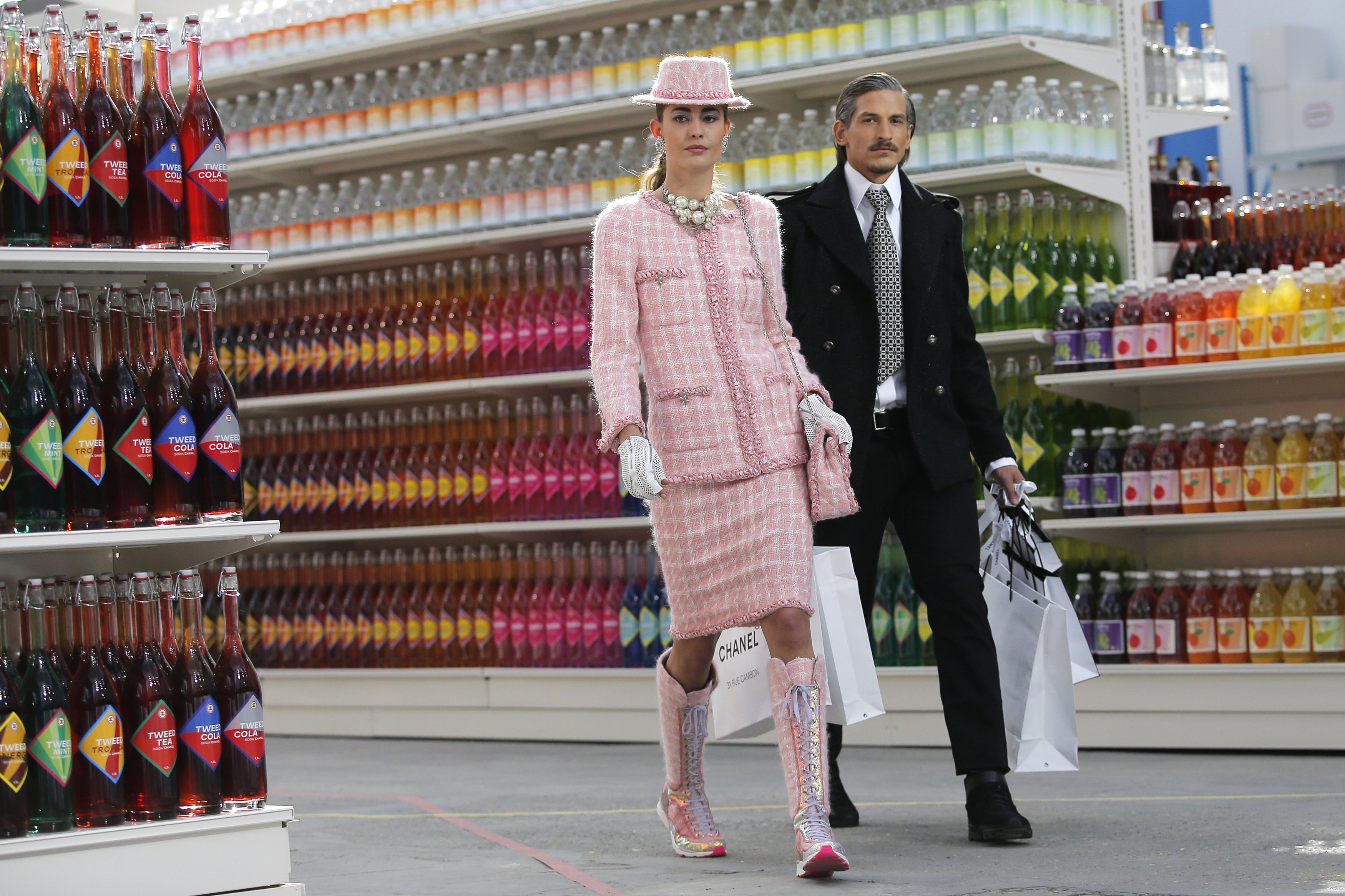 """Models present creations by German designer Karl Lagerfeld as part of his Fall/Winter 2014-2015 women's ready-to-wear collection for French fashion house Chanel at the Grand Palais transformed into a """"Chanel Shopping Center"""" during Paris Fashion Week March 4, 2014."""