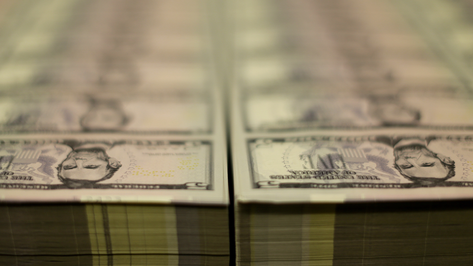Stacks of Lincoln five dollar bill are seen  at the Bureau of Engraving and Printing in Washington