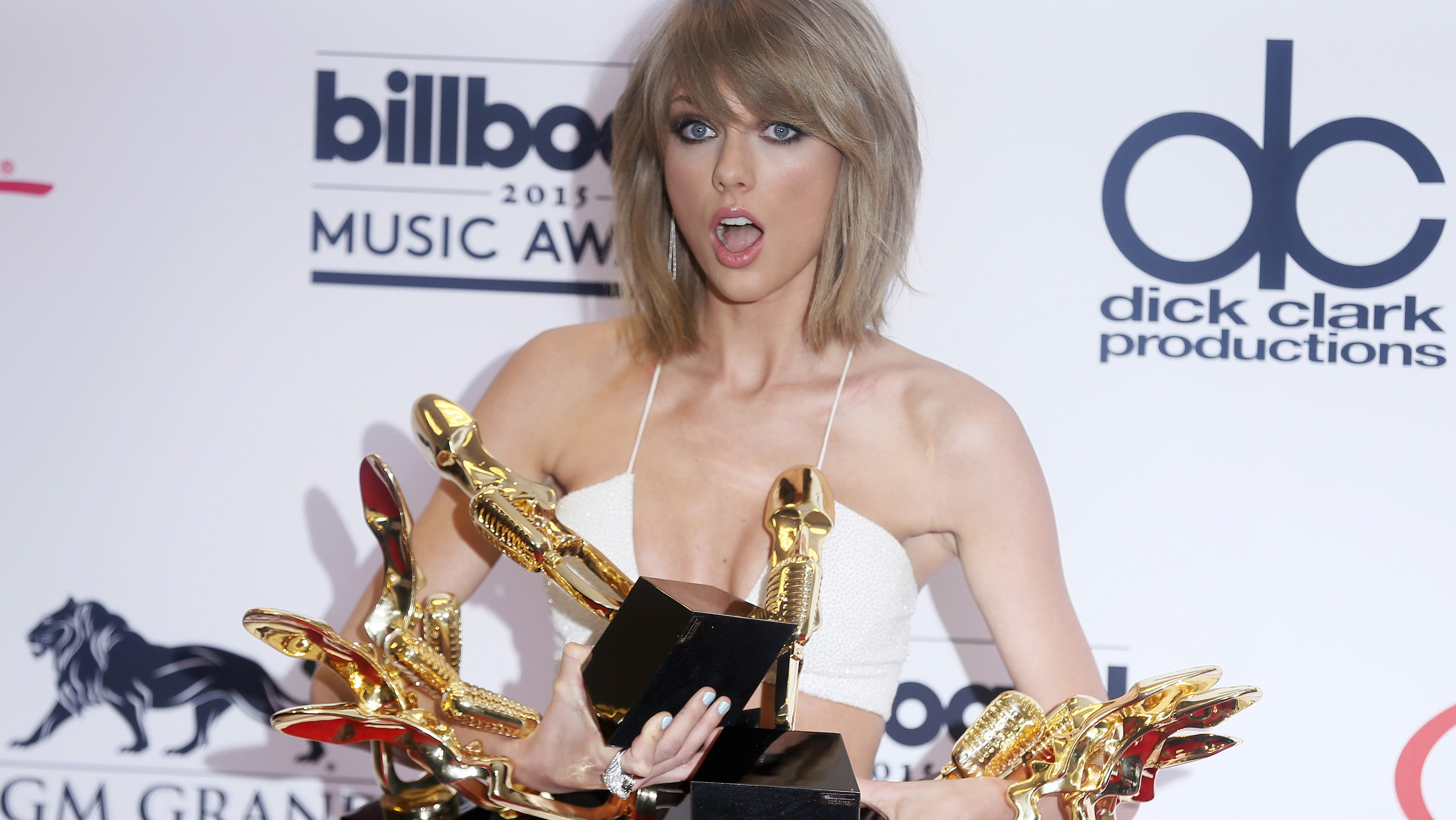 Taylor Swift poses with her awards during the 2015 Billboard Music Awards in Las Vegas