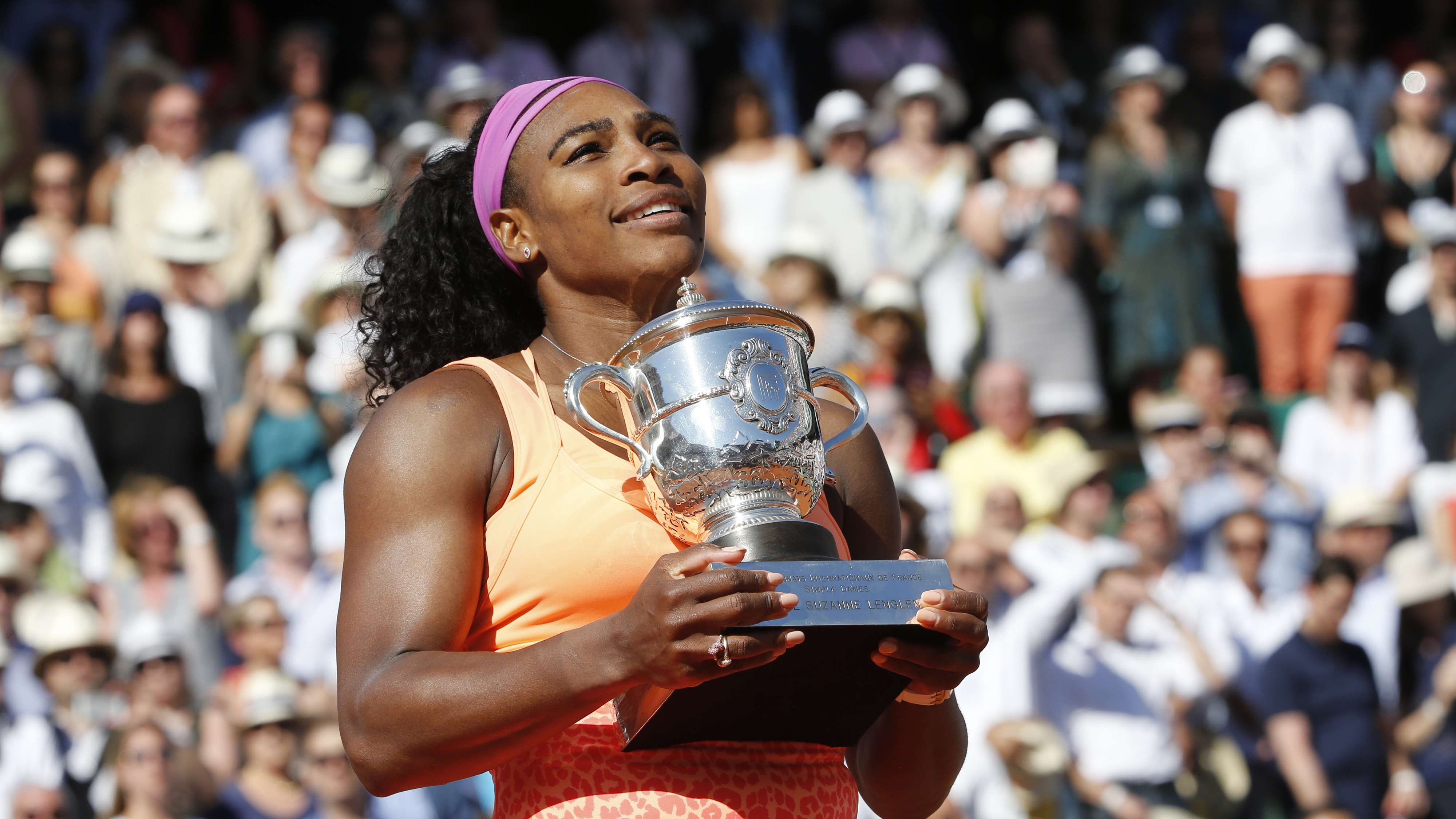Serena Williams of the U.S. poses with the trophy during the ceremony after defeating Lucie Safarova of the Czech Republic during their women's singles final match to win the French Open tennis tournament at the Roland Garros stadium in Paris, France, June 6, 2015.