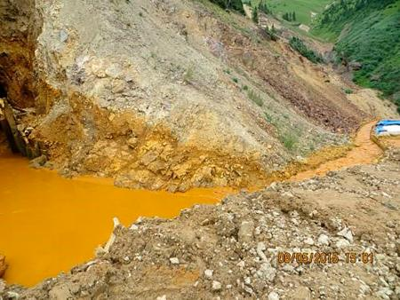 Yellow mine waste water is seen at the entrance to the Gold King Mine in San Juan County, Colorado, in this picture released by the Environmental Protection Agency (EPA) taken August 5, 2015.