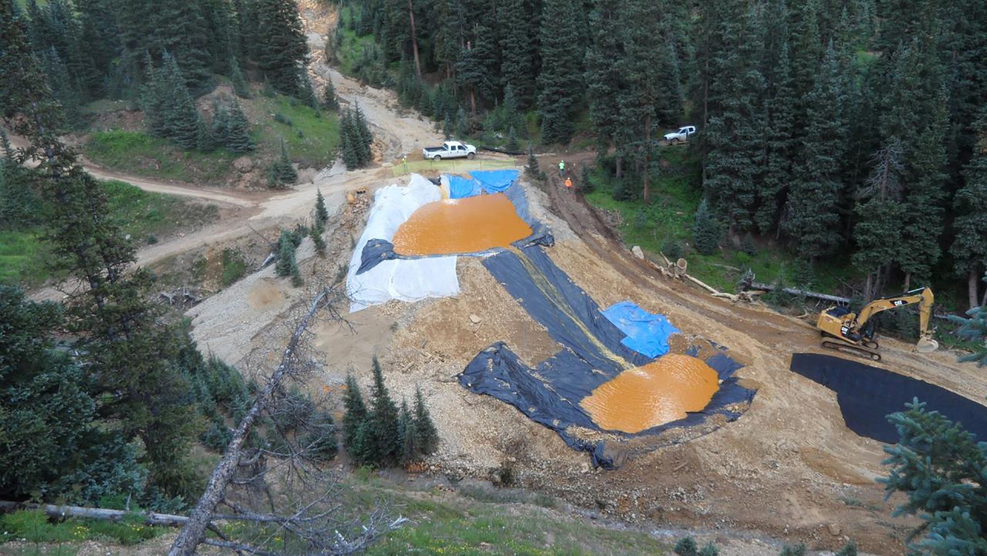 Yellow mine waste water from the Gold King Mine collects in holding pools in San Juan County, Colorado, is seen in this picture released by the Environmental Protection Agency (EPA) taken August 7, 2015. A contaminated plume of waste water accidentally released from a Colorado gold mine by U.S. environmental agency workers has spread downstream and reached northern New Mexico