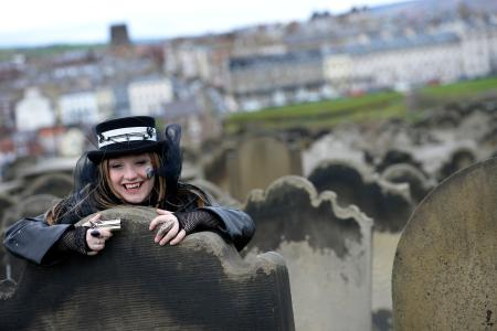 A woman poses for photographs during the Goth festival in Whitby, northern England April 28, 2013. The Goth culture emerged from the Punk scene in the 1980's, developing its own music and fashion styles. The festival in Whitby is now in it's 19th year and attracts around ten thousand people over the weekend.
