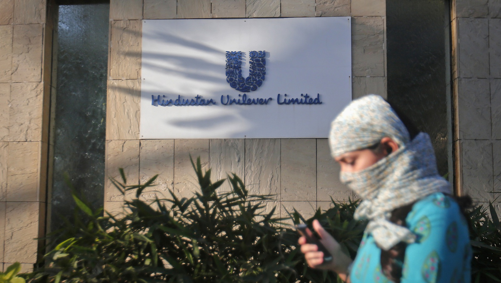 A pedestrian walks past the Hindustan Unilever Limited (HUL) headquarters in Mumbai April 29, 2013. Hindustan Unilever Ltd will intensify a price war against lesser-known detergent and skincare brands this year as it seeks to win back India's increasingly thrifty shoppers and reverse four consecutive quarters of slowing sales.