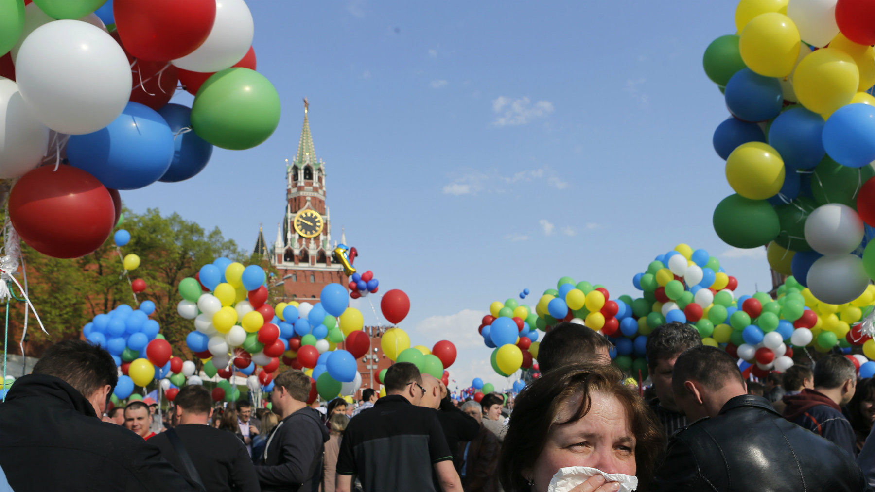 People walk with balloons towards Red Square during a rally in Moscow.