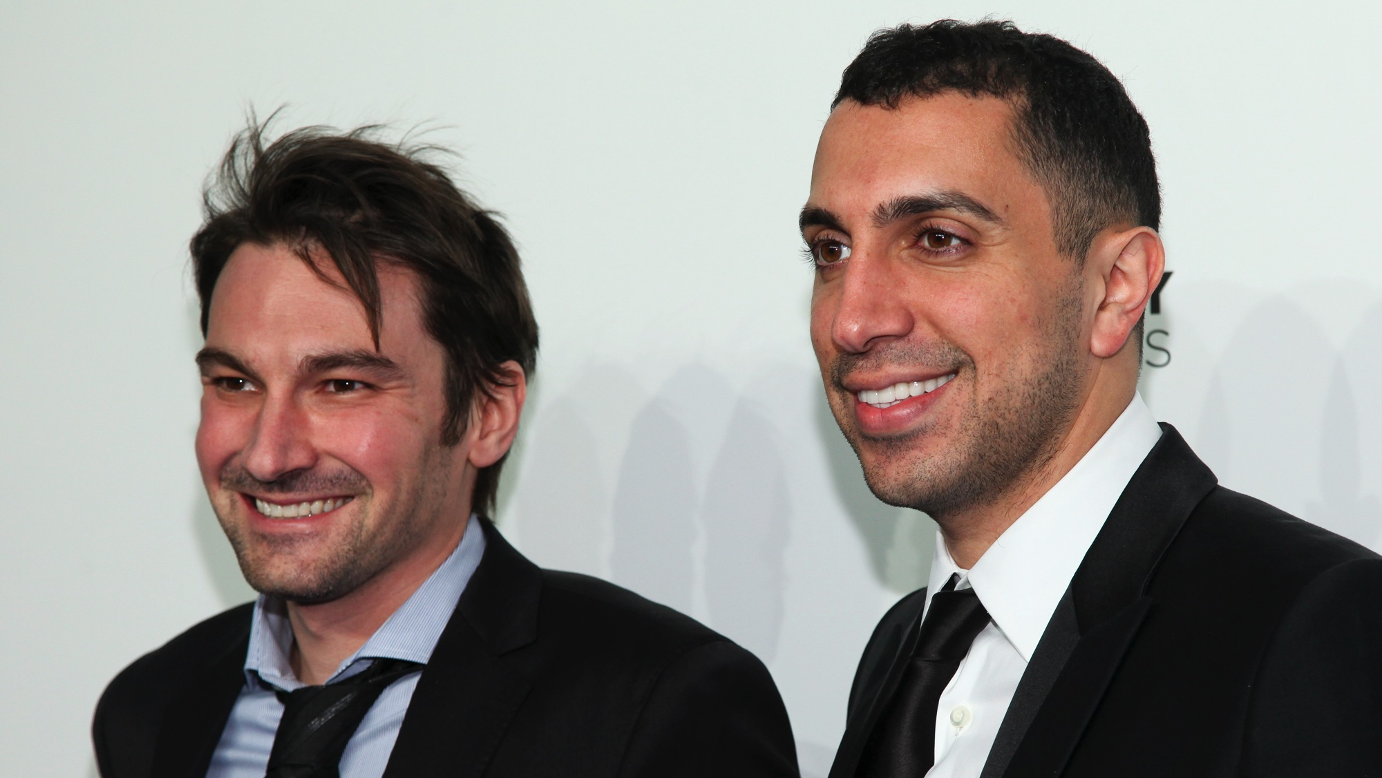 Co-founders of Tinder Jonathan Badeen, left, and Sean Rad, right, attend the 19th Annual Webby Awards at Cipriani Wall Street on Monday, May 18, 2015, in New York. (Photo by Andy Kropa/Invision/AP)