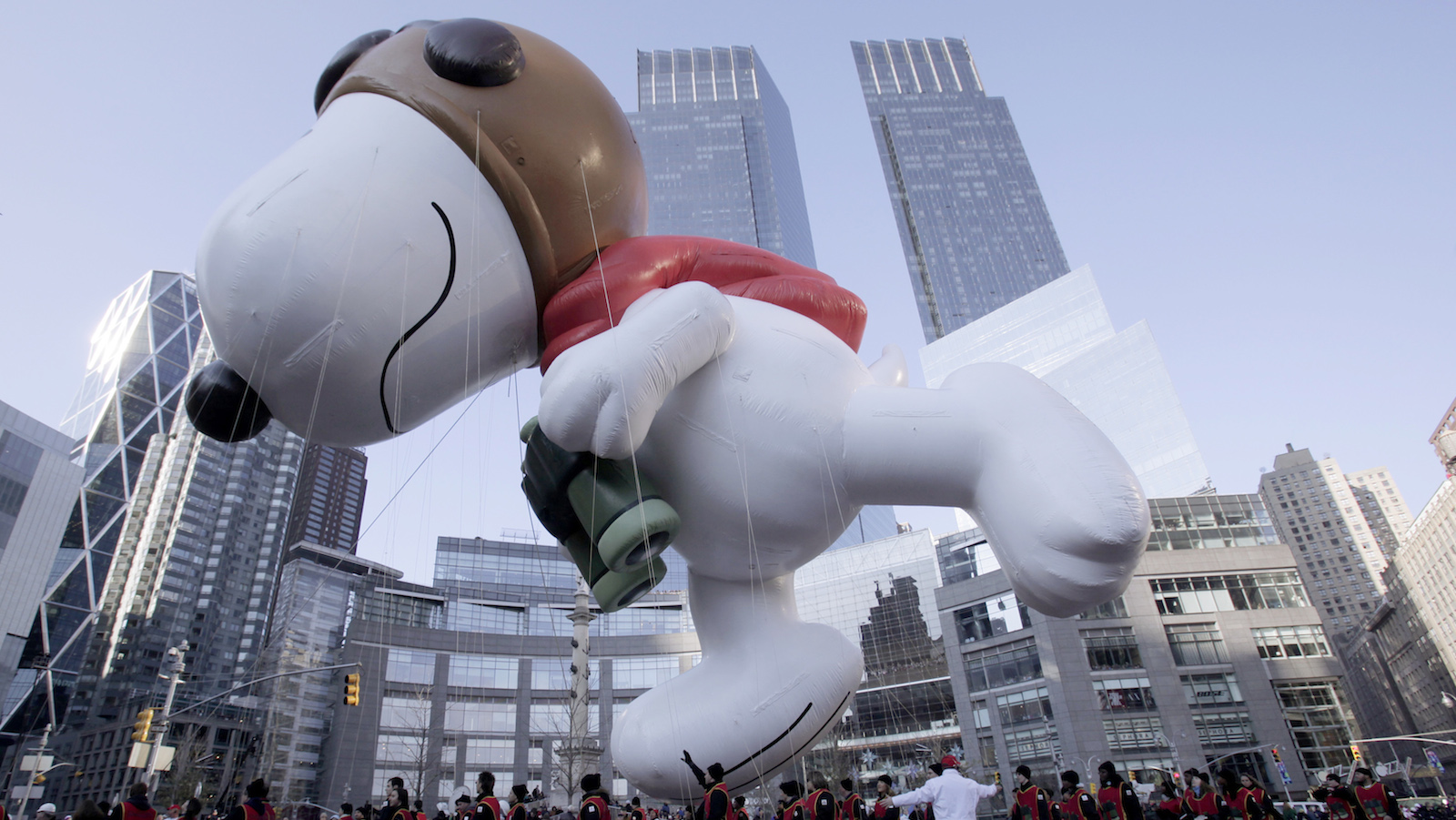 The Snoopy balloon makes its way through Columbus circle during The Macy's Thanksgiving day parade in New York