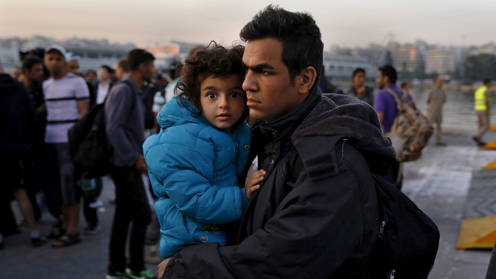 Syrian refugees disembark from a Greek ferry after arriving in the port of Piraeus near Athens June 14, 2015.