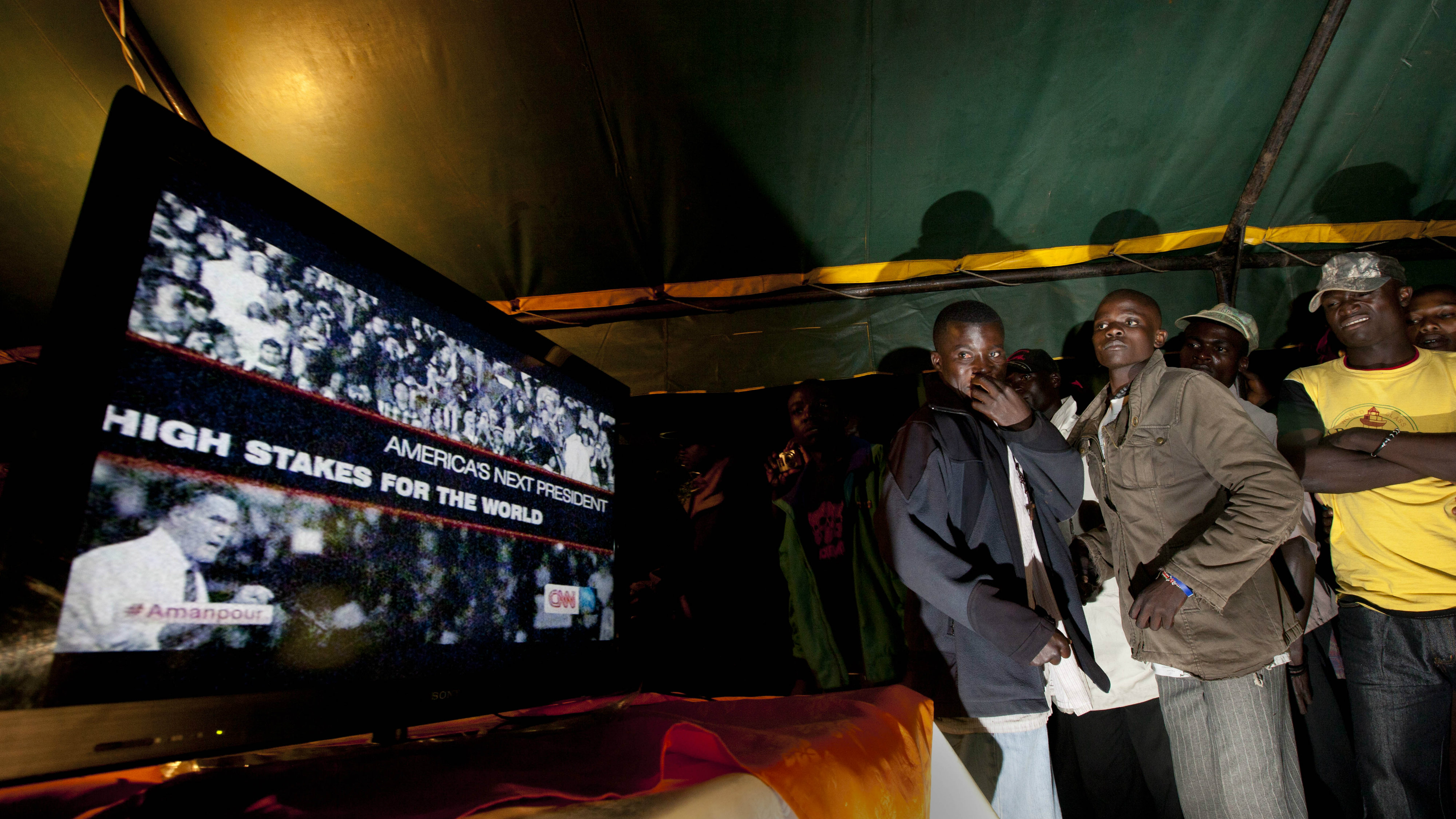 Villagers watch television news at an all-night party to watch the U.S. presidential election in Kogelo, in western Kenya.