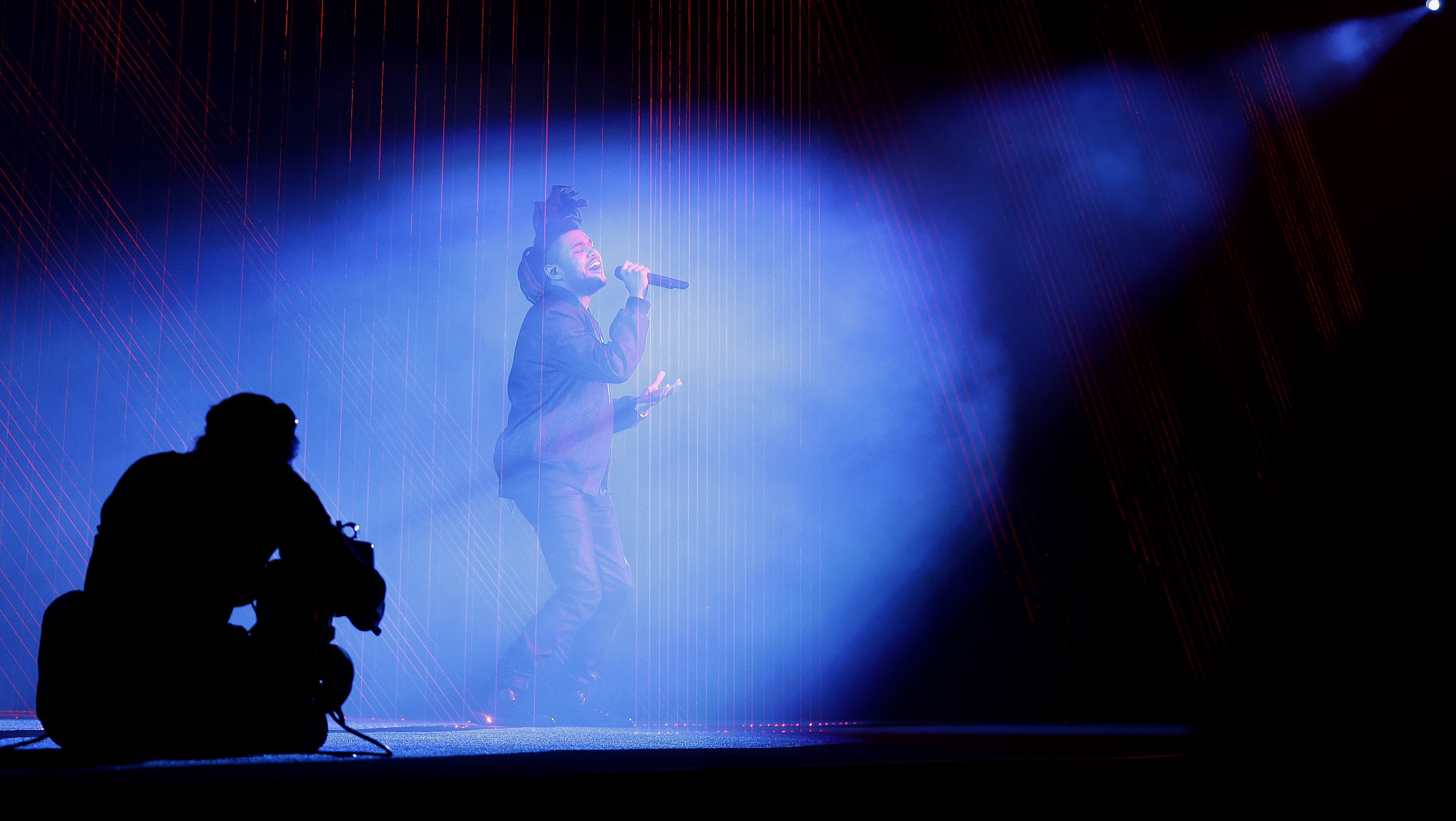 """The Weeknd performs at the Apple Worldwide Developers Conference in San Francisco, Monday, June 8, 2015. The maker of iPods and iPhones announced Apple Music, an app that combines a 24-hour, seven-day live radio station called """"Beats 1"""" with an on-demand music streaming service."""