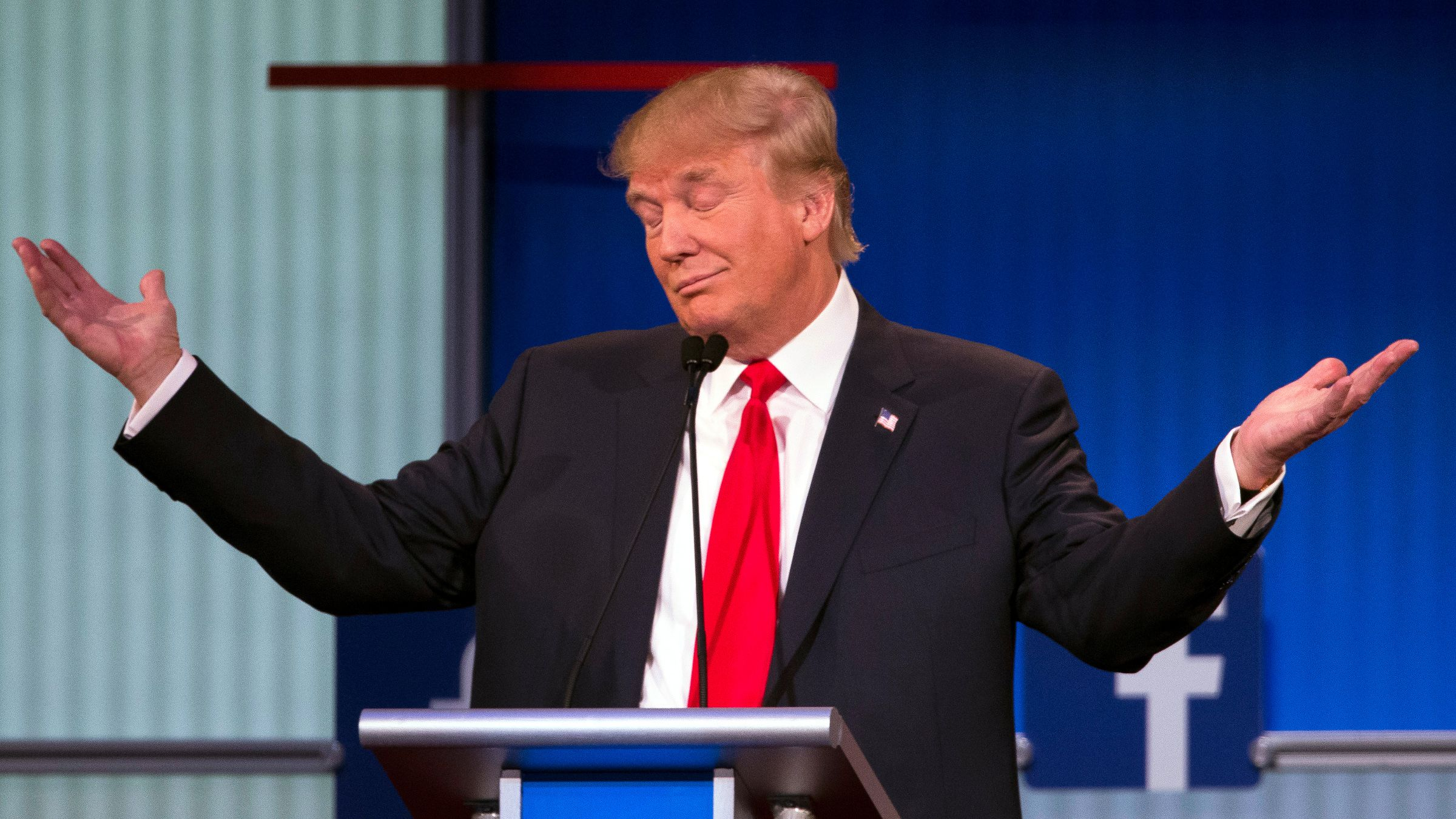 Republican presidential candidate Donald Trump gestures during the first Republican presidential debate at the Quicken Loans Arena Thursday, Aug. 6, 2015, in Cleveland.