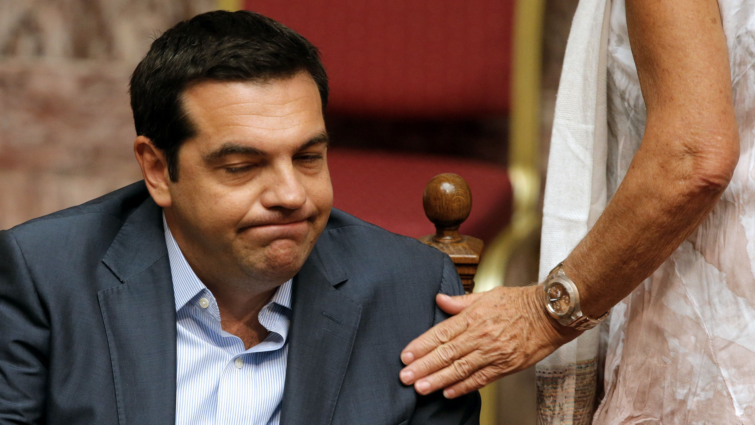 Greek Prime Minister Alexis Tsipras reacts as he attends a parliamentary session in Athens, Greece, August 14, 2015. Tsipras confronted a widening rebellion within his leftist Syriza party as parliament voted to approve the country's third financial rescue by foreign creditors in five years.