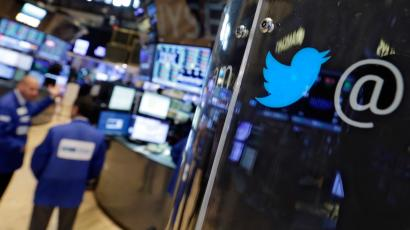 The logo for Twitter adorns a phone post on the floor of the New York Stock Exchange, Tuesday, July 28, 2015. Twitter surprised investors with a strong earnings report Tuesday even as the company searches for a permanent CEO and faces ongoing challenges growing its user base. (AP Photo/Richard Drew)