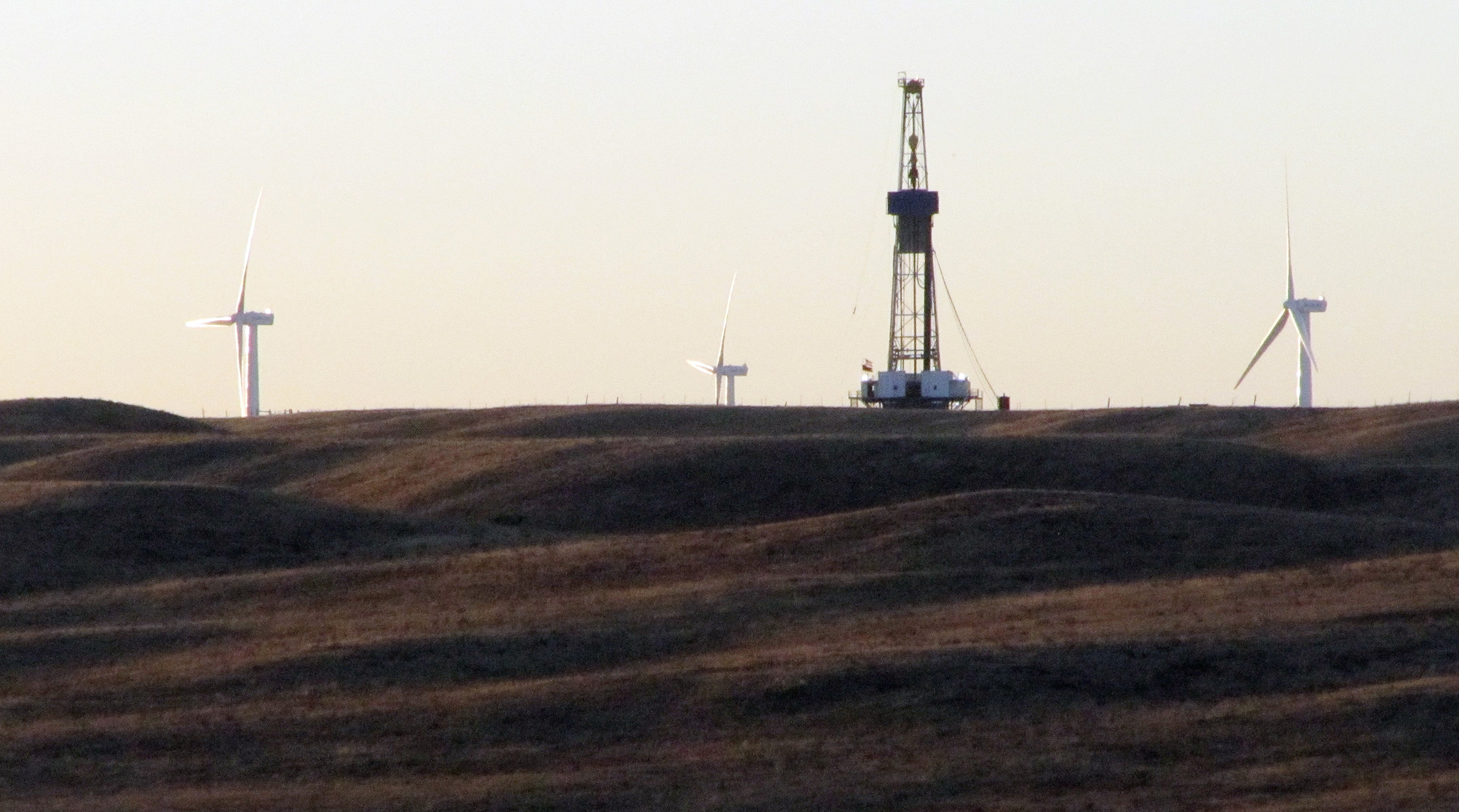This file photo taken Thursday, Sept. 30, 2010, shows an oil rig drilling a well for QEP Resources Inc., on ranch land a few miles west of Cheyenne, Wyo.