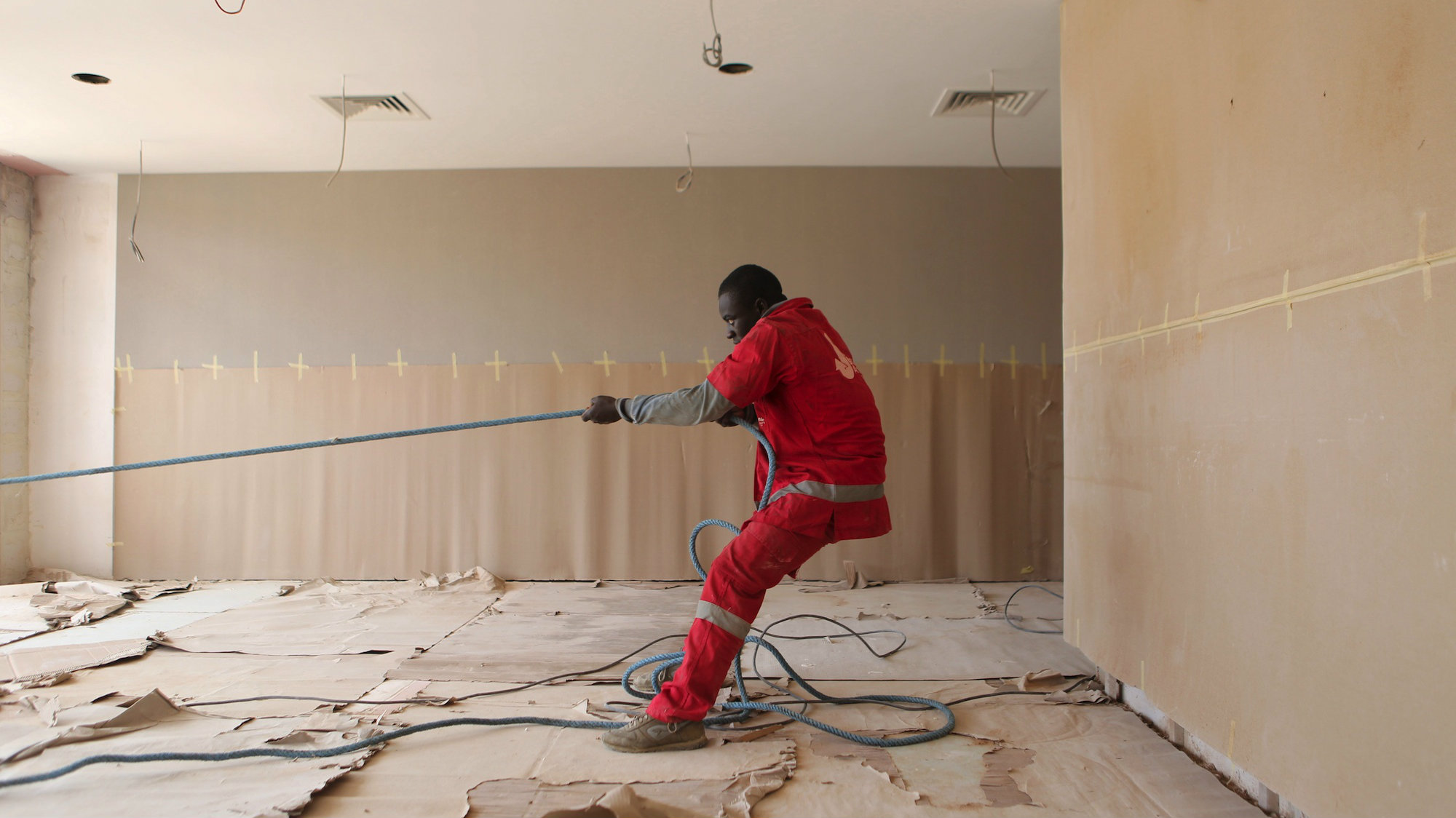 A worker at the construction site for the Radisson hotel being built in Abidjan, Ivory Coast.
