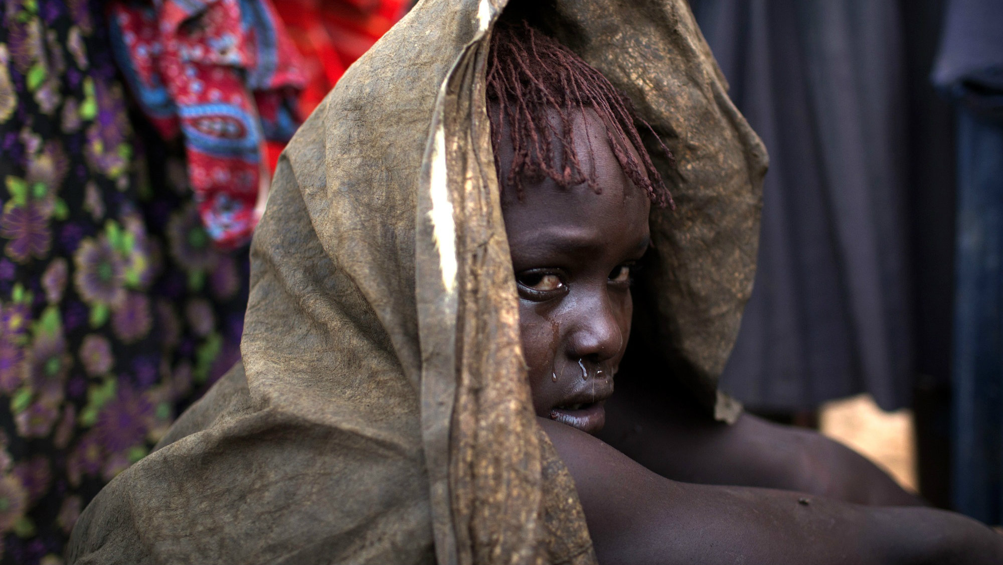 A girl in Baringo County Kenya cries after being circumcised