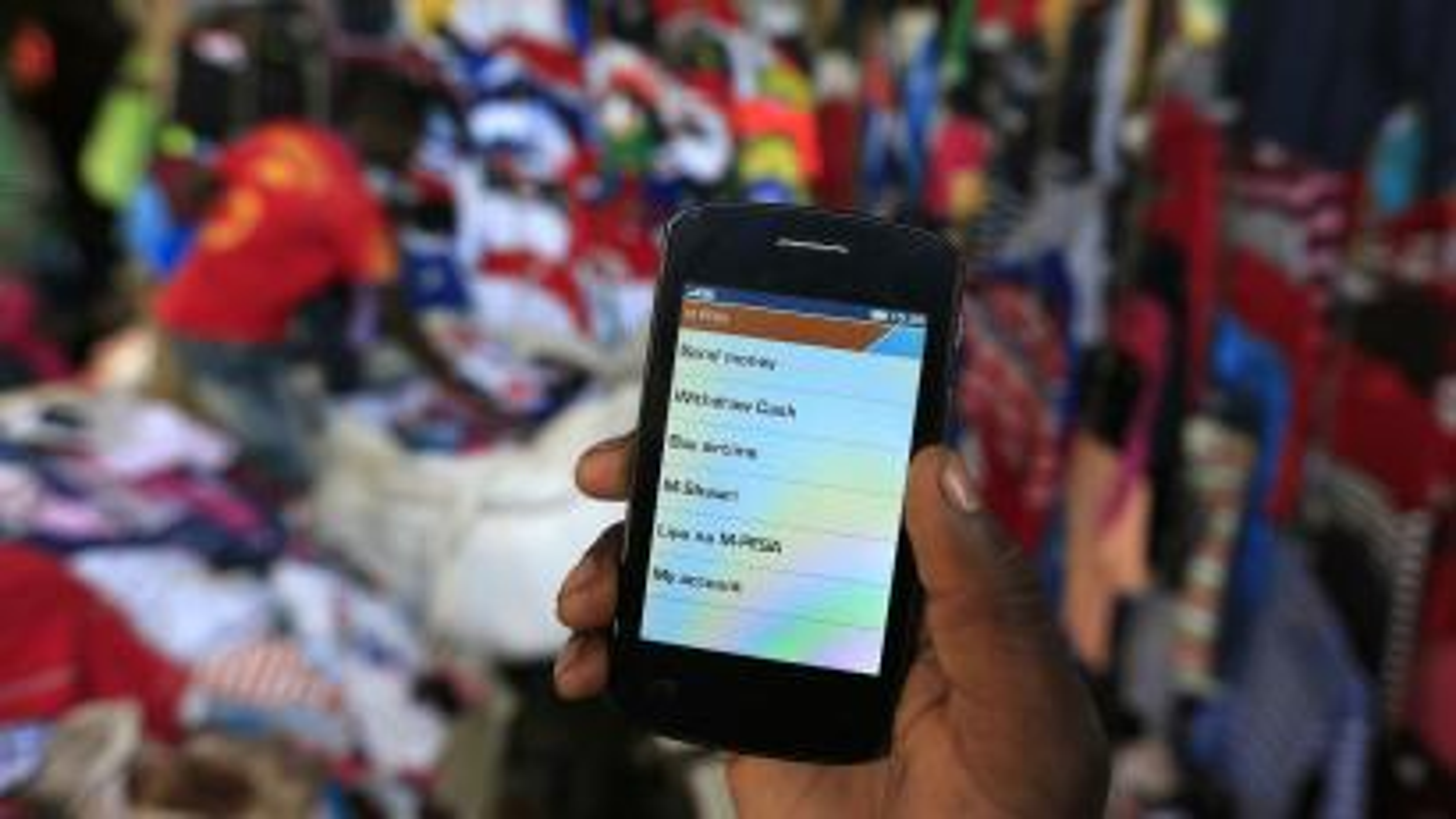 A man uses his M-Pesa account in Nairobi.