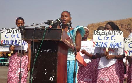 Moussoukoura Sidy, center, reads a declaration for the abandonment of female circumcision in Bamako, Mali, on Feb. 6, 2014.