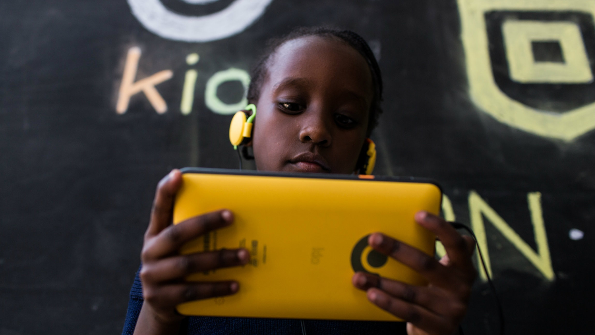 A student plays with the Kio, a tablet made by BRCK Education