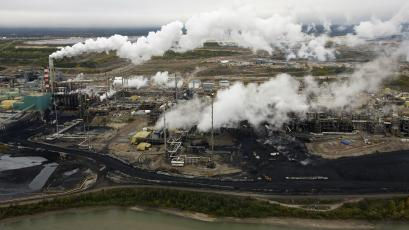 A tar sands procession plant near the Athabasca River in Alberta, Canada.