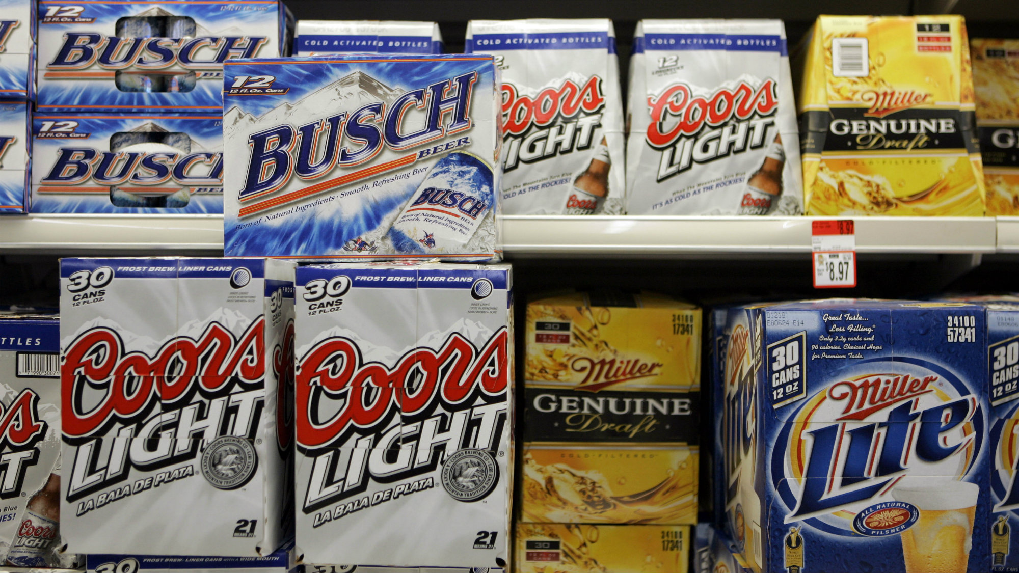 Products from Coors, Miller and Anheuser-Busch sit in a grocery store cooler.