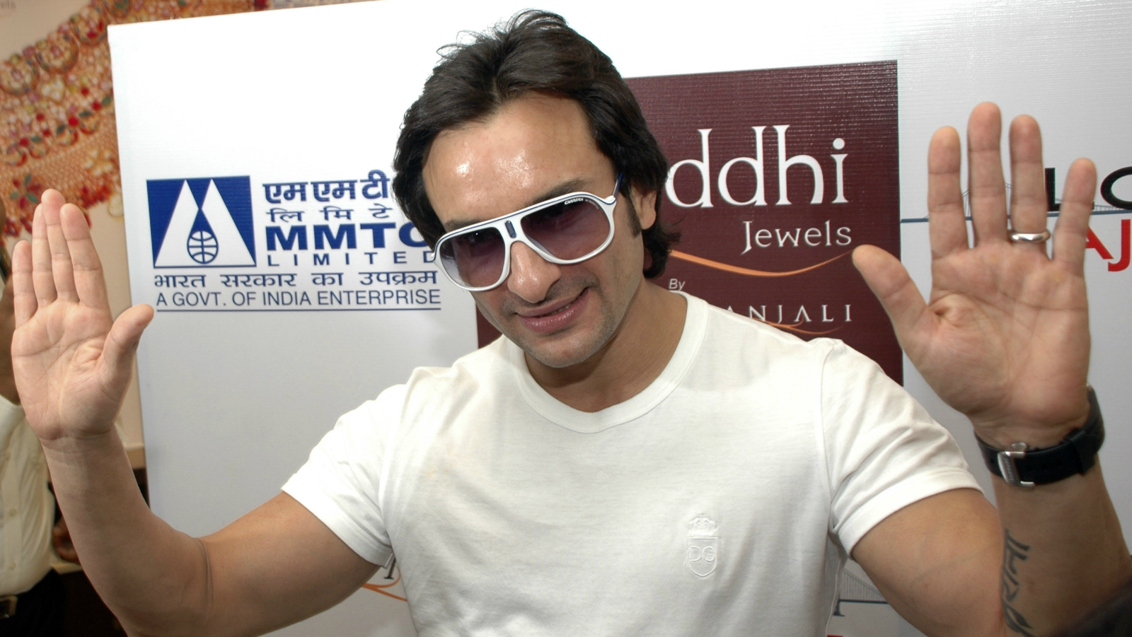 """Bollywood actor Saif Ali Khan gestures during his visit to a jewelry store to felicitate the winner of a contest and also promote his upcoming film """"Love Aaj Kal"""" or Love these days, in Ahmadabad, India, Wednesday, July 22, 2009."""