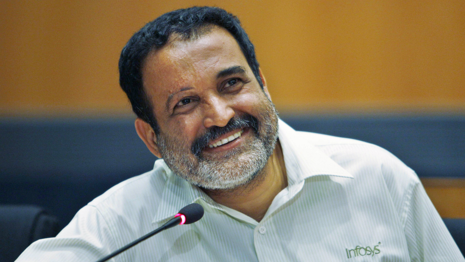 Infosys Technologies board member T.V. Mohandas Pai speaks after announcing his decision to retire, at their headquarters in Bangalore, India, Friday, April 15, 2011. Infosys Technologies reported an 18.9 percent rise in quarterly profit in dollar terms Friday.