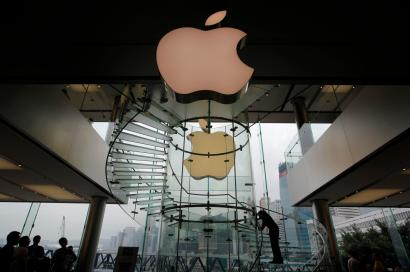 A worker cleans up the interior part near an Apple logo before its lighting is turned off to mourn the Apple founder and former CEO Steve Jobs at an Apple store in Hong Kong, Thursday, Oct. 6, 2011. Jobs died on Wednesday at the age of 56. (AP Photo/Vincent Yu)
