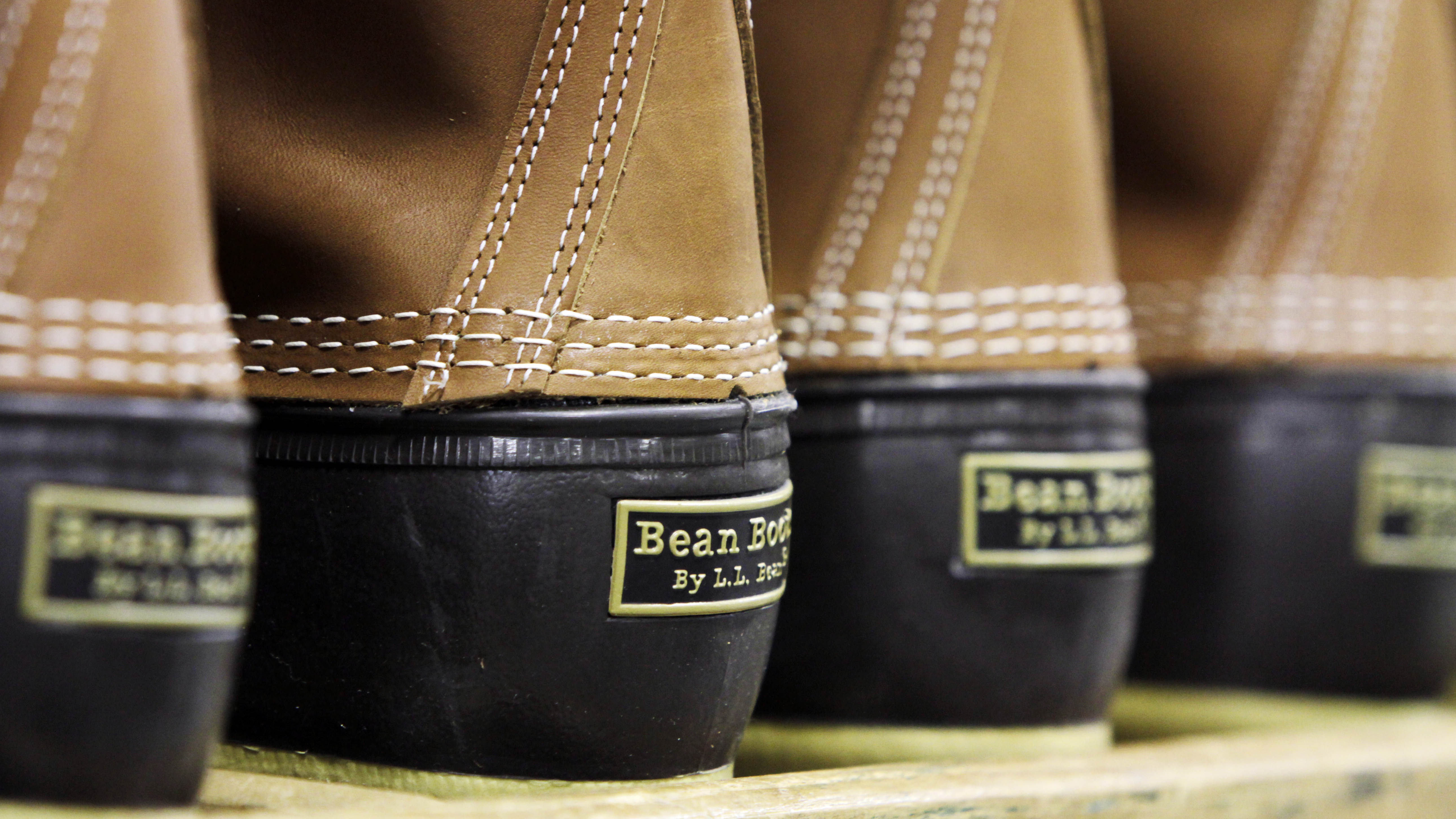 In this Dec. 14, 2011 photo, pairs of boots are seen in the facility where L.L. Bean boots are assembled in Brunswick, Maine. L.L. Bean's famed hunting boots are seeing a surge in popularity, necessitating the hiring of more than 100 additional employees to make them.