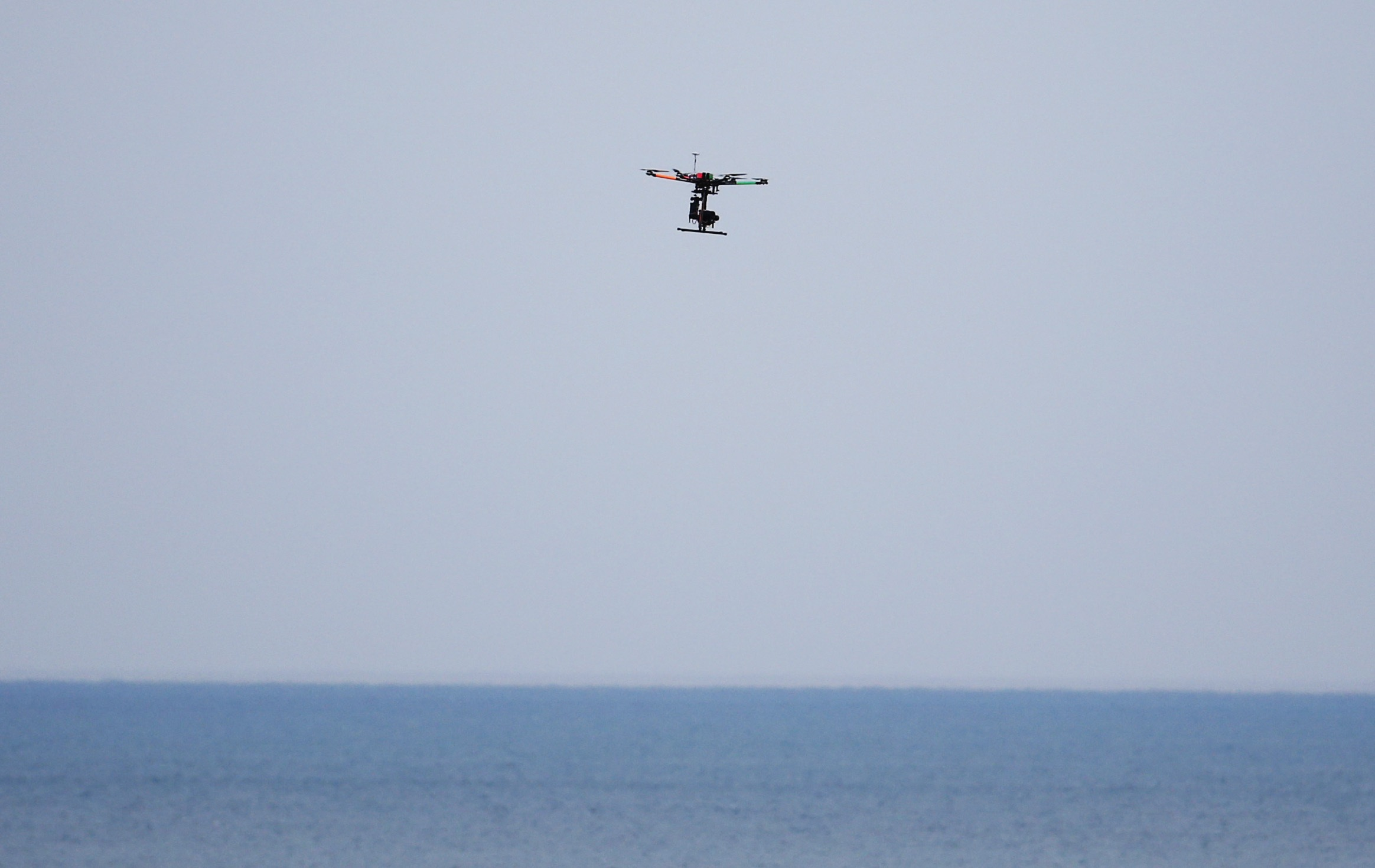 A drone flies near the 17th hole during the first round of the PGA Championship golf tournament Thursday, Aug. 13, 2015, at Whistling Straits in Haven, Wis. (AP Photo/Julio Cortez)
