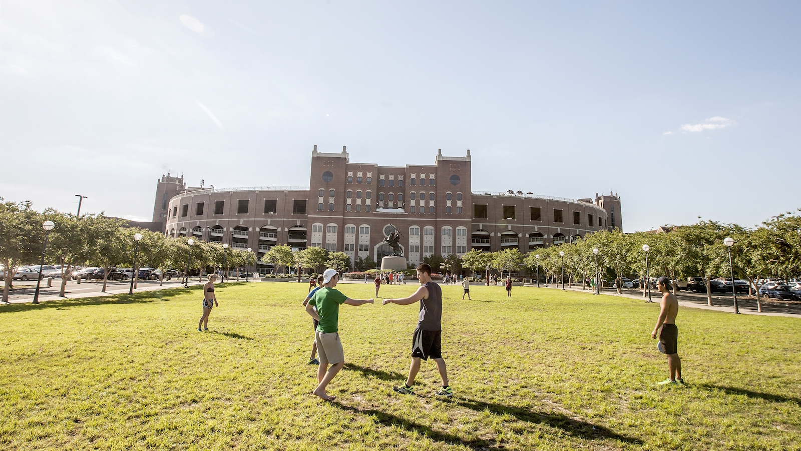 Florida State University students play disk football on Langford Green in front of Doak S. Campbell Stadium on the campus of Florida State University in Tallahassee, Fla., Friday April 30, 2015. (AP Photo/Mark Wallheiser)