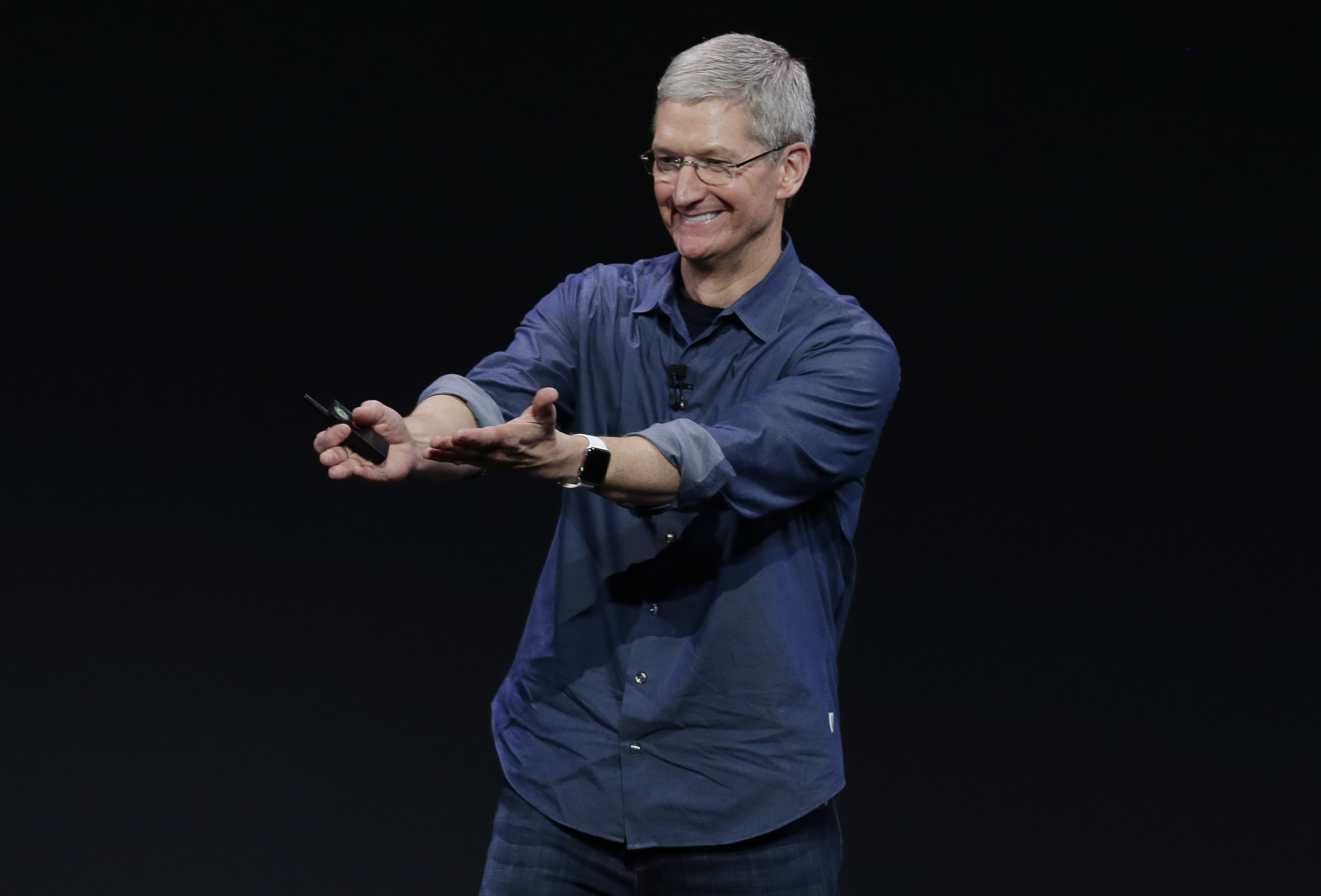 Apple CEO Tim Cook introduces Apple Watch , which he is wearing on his wrist, on Tuesday, Sept. 9, 2014, in Cupertino, Calif.