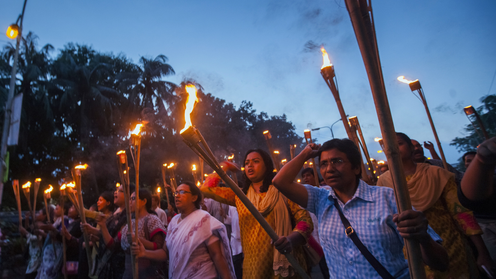 Bangladeshi secular activists participate in a torch rally held to protest against the killing of blogger Niloy Chottopadhay, 40, in Dhaka, Bangladesh, Saturday, Aug. 8, 2015. Suspected militants posing as tenants entered an apartment building and hacked to death the secular blogger in Bangladesh's capital in the fourth such deadly attack this year, police said.