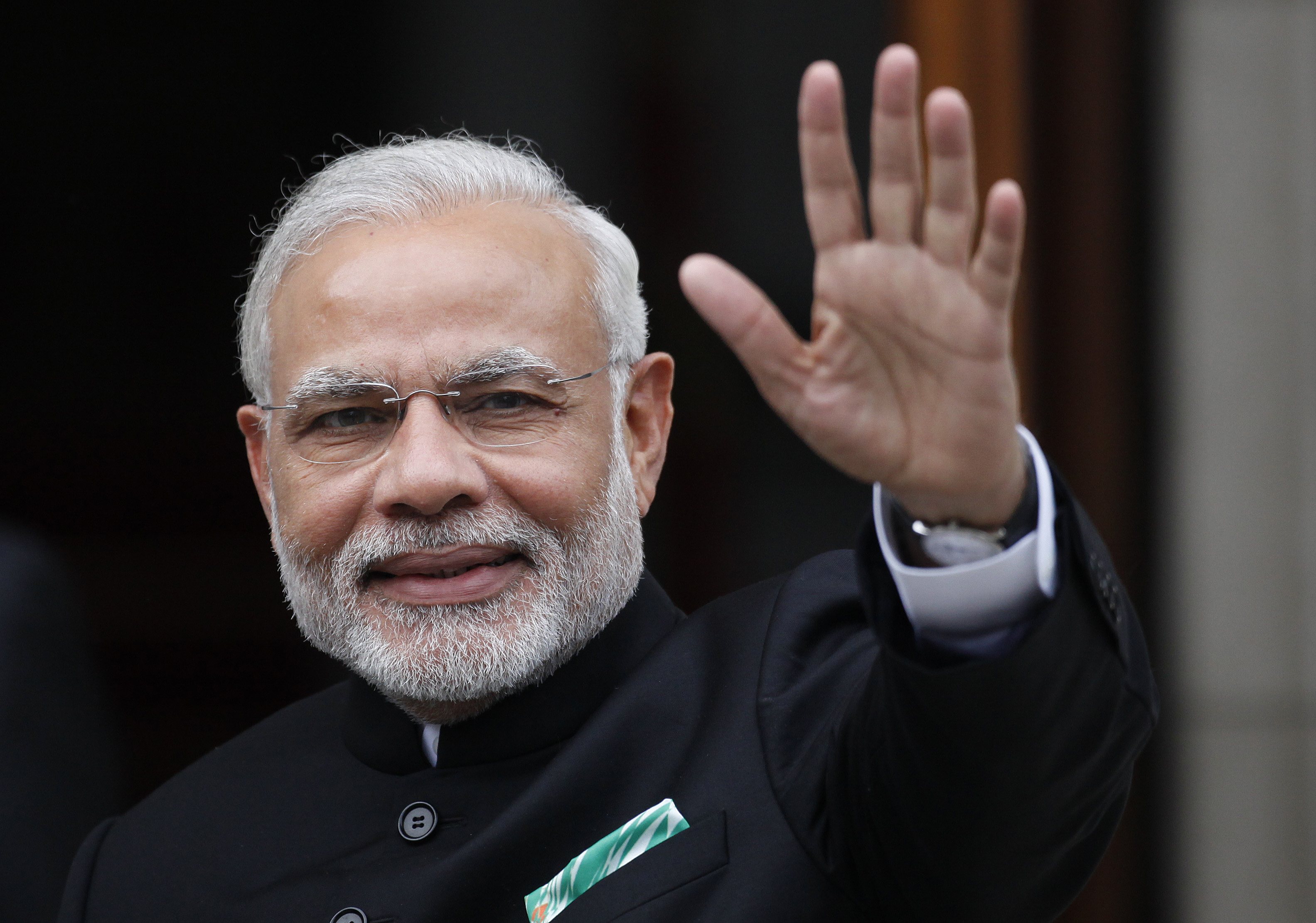Indian Prime Minister Narendra Modi waves as he arrives for a meeting with Irish Prime Minister Enda Kenny at Government Buildings, Dublin, Ireland, Wednesday, Sept. 23, 2015. Modi arrived in Ireland for high level talks focusing on strengthening economic, trade and investment between the two countries. (AP Photo/Peter Morrison)