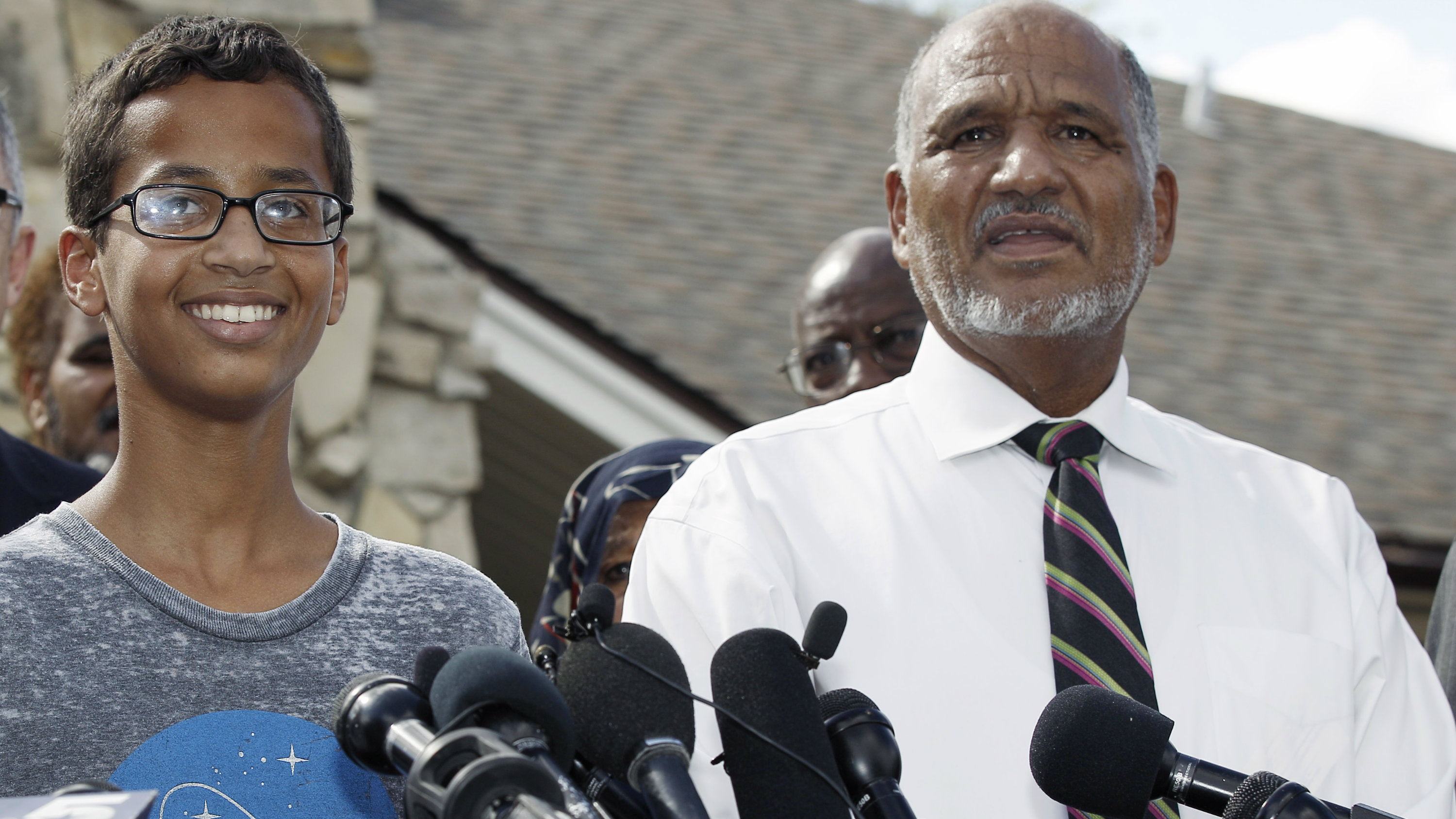 Ahmed Mohamed, 14, left, and his father, Mohamed Elhassan Mohamed, thank supporters during a news conference at their home, Wednesday, Sept. 16, 2015, in Irving, Texas